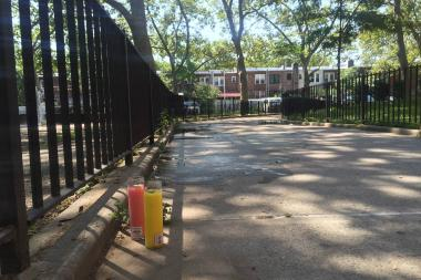 Candles were placed at the site of the shooting. Photo via DNAinfo/William Mathis