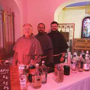 Friars manning the bar at San Damiano Mission