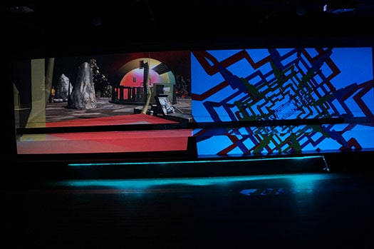 "Projections of Miyo Van Stenis' ""War Room"" (left) and Brenna Murphy's work (right)"