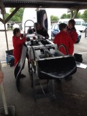 Last minute race preparation in the garage at Goodwood Motor Circuit Greenpower heat