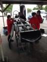 Last minute race preparation in the garage at Goodwood Motor Circuit Greenpower heat