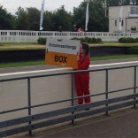 Lydia puts Pit board out at Goodwood greenpower Heat