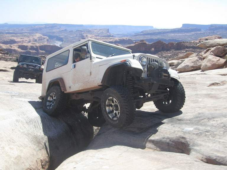 Jeep Off-Roading Over Rock Gap