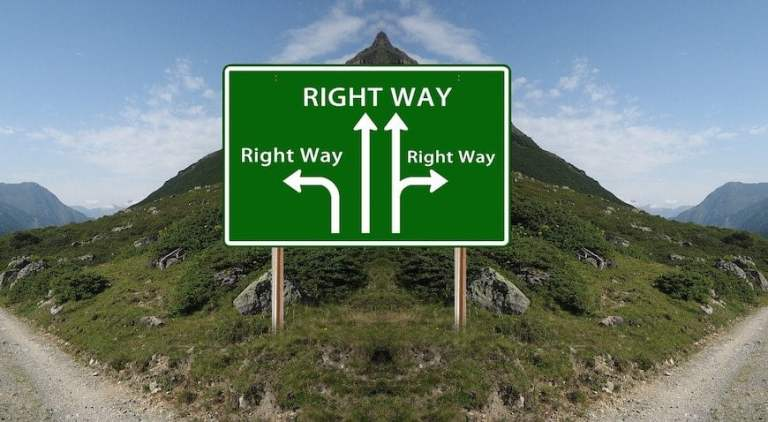 Two Roads With Right Way Sign