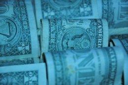 Dollar Bill Rolls in Blue Tint