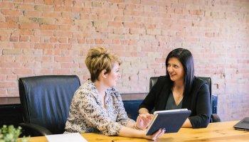 Two Women Talking Business