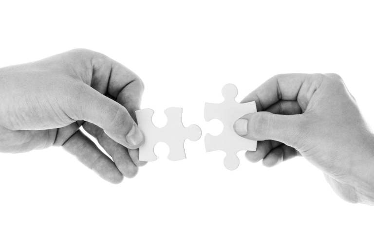 Hands Connecting Puzzle Pieces Black and White