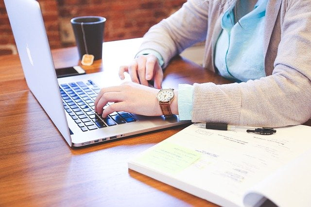 Person Typing on Laptop at Desk