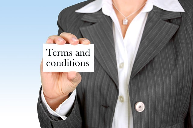 Woman Holding Terms and Conditions Card