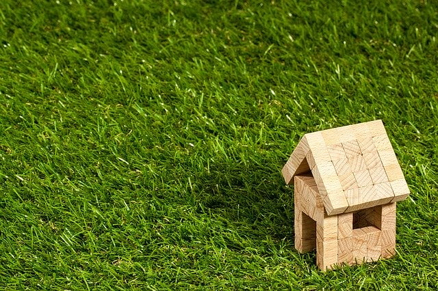 Wooden House Model on Grass