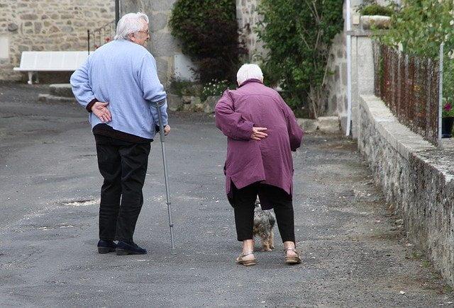 Two Older People Walking