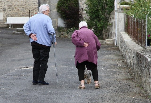 Two Older People Walking