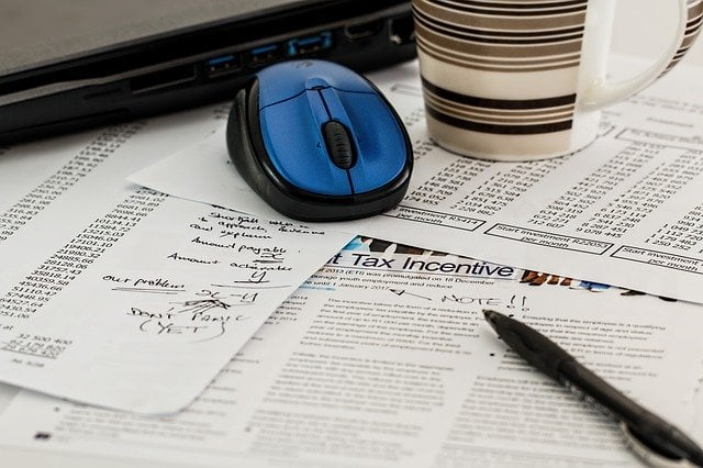 Tax Forms and Computer Mouse