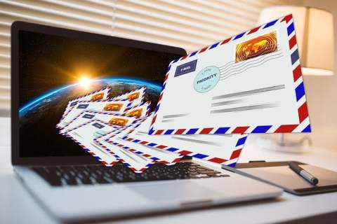 Laptop with Email Letters Flying Out