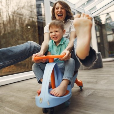 Woman Riding Car Toy with Smiling Child