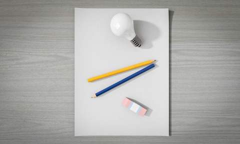Paper with Light Bulb and Writing Tools