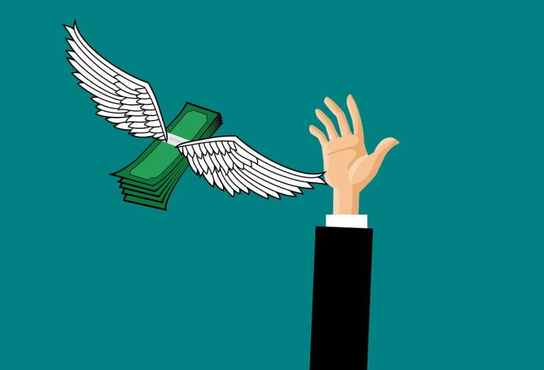 Hand Reaching to Catch Flying Money
