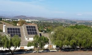 2 Solar arrays on roof of house