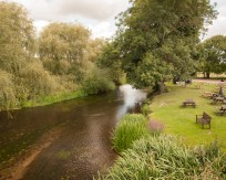 The River Stour at Wye, Kent, UK, showing the pub garden of the Tickled Trout