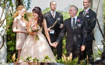 "The happy couple are beaming after saying their ""I do's."""