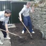 Preparing the community garden flower bed