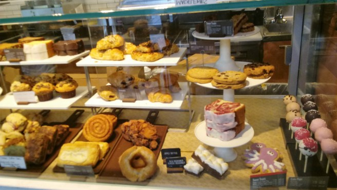 Starbucks - pastry case. Starbucks Social and Environmental Impact