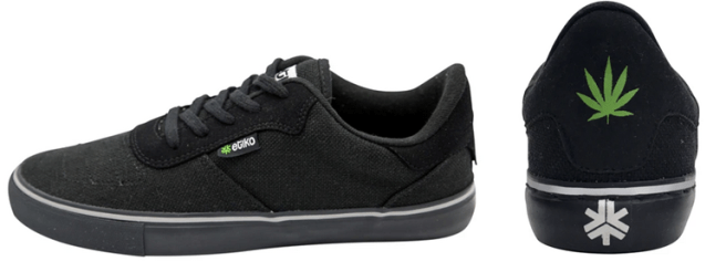Sneakers made from hemp by Etiko. A side and back view of the low-top shoes that are black in color with an image of a hemp leaf and the Etiko logo on the back and a small Etiko label on the side..