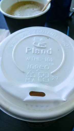 Peet's Coffee – sustainability and social responsibility. A photo of a compostable coffee cup lid from Peet's Coffee is shown. The lid is made from poly-lactic acid by Ingeo.