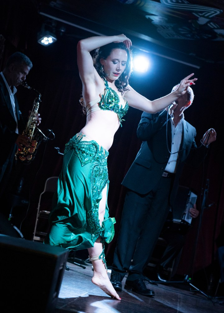 Siobhan Camille of Greenstone Belly Dance on stage with Zaher Assaf, Guy Schalom and the Baladi Blues Ensemble in London, England