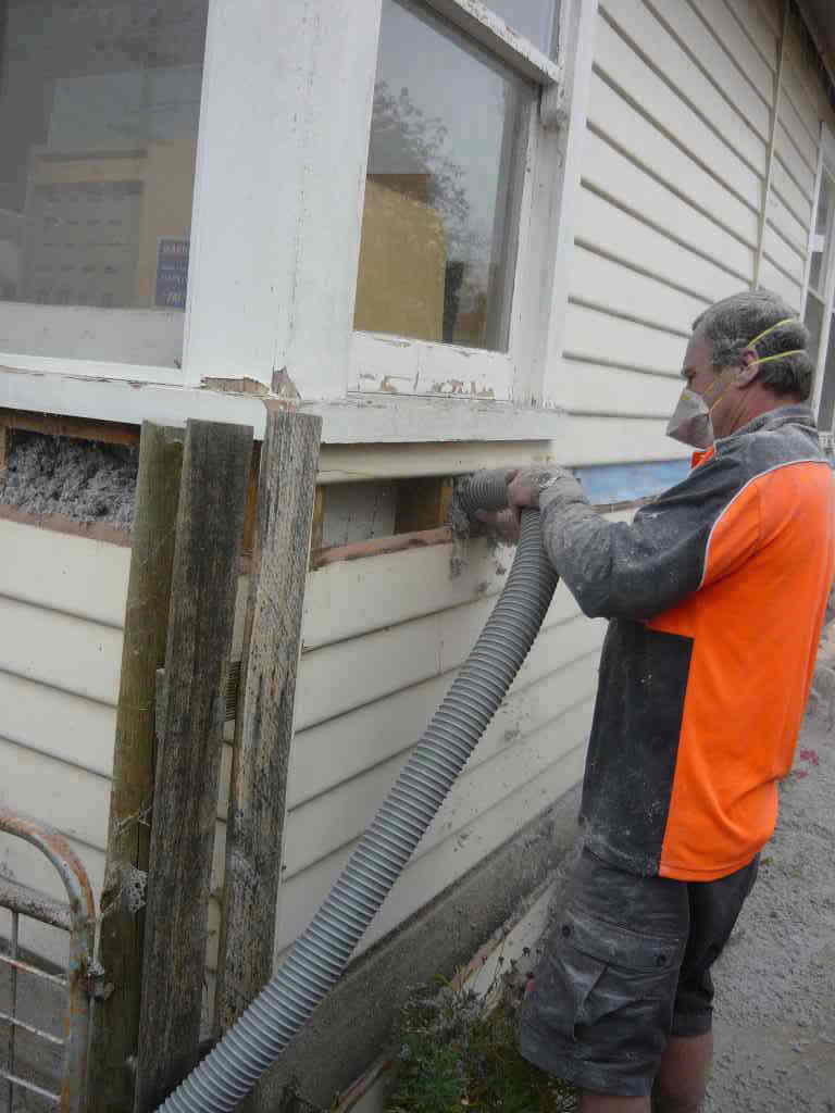 Kev pumping insulation into wall