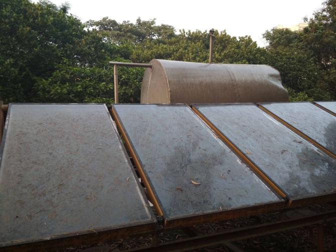 Figure 9: A solar water heater and solar panels on top of one of the hostels for providing hot water in the washrooms.