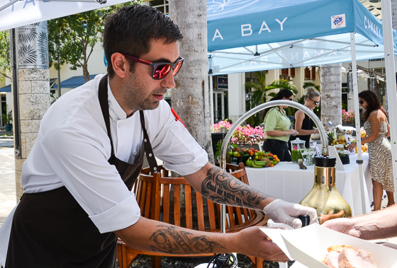 Chef Will O'Hara connects with visitors to the food market .