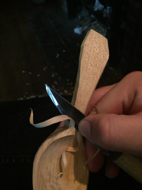knife slicing a bevel toward the bowl