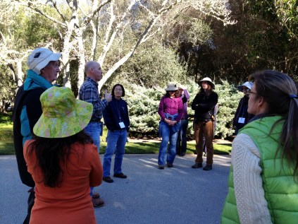 Alex Fernandez, the Garden Manager (center left), gives a brief lecture on pruning methods.