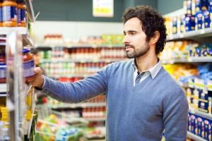 Gentleman looking at a food package