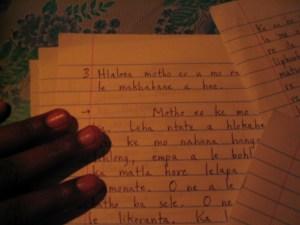 Some of my Sesotho homework, under candle light.