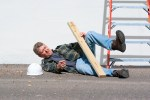 Injured construction worker fallen off ladder
