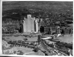 Maiden flight of CNAC's Douglas Dolphin, Oct 1934 Broadway Mansions and Garden Bridge behind the plane's tail