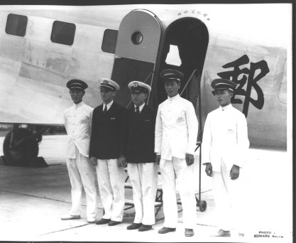 CNAC's first DC-2 crew: Hewitt Mitchell and Moon Fun Chin (with three airport porters)