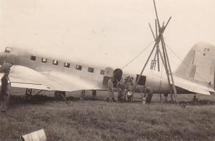 Repairing a DC-2 tail wheel, 1935 or '36