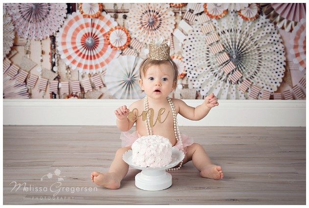 Cake smash photography session with gold and pink colors