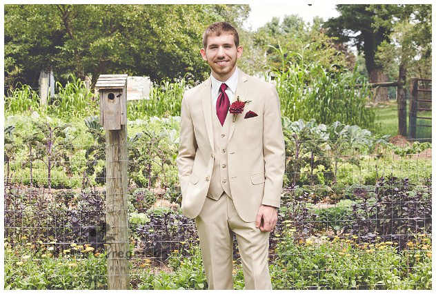 The off white suite of the groom really made the Burgandy flowers pop!