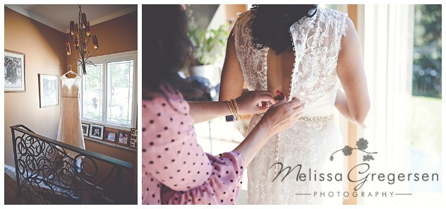 Bridal gown hanging in a beautiful stairway and her mother helping her into it.