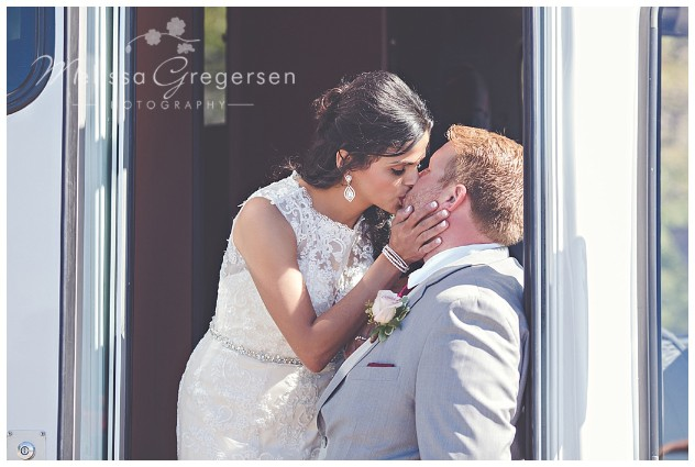 Bride and groom sharing a moment before getting on the party bus!