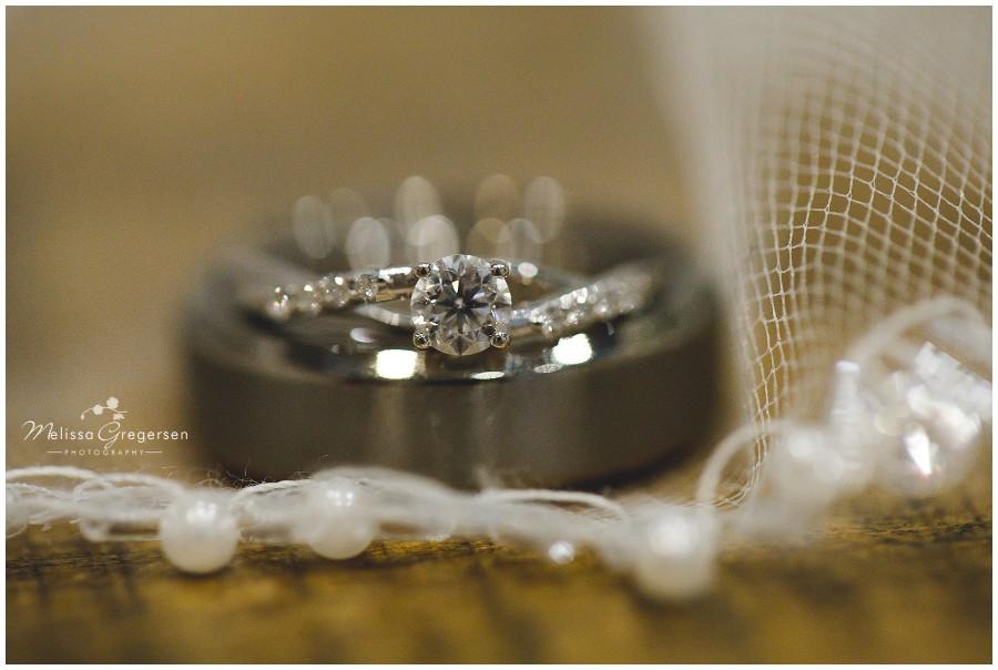 Wedding rings laying on bridal veil