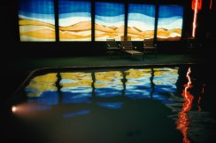 Lights from a neon sign and a stained glass window, reflected in a swimming pool, California, USA, July 1977. (Photo by Ernst Haas/Hulton Archive/Getty Images)