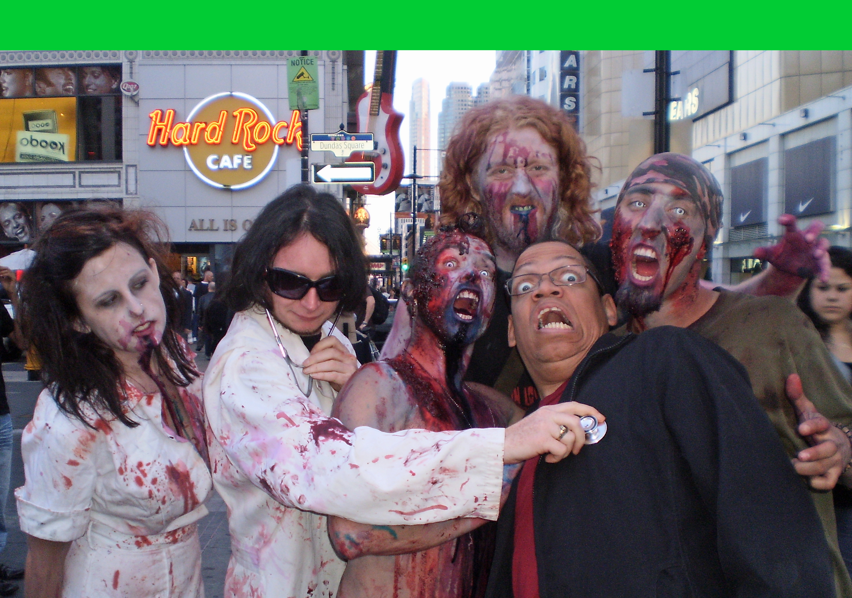 Greg Morton attacked by Zombies in Dundas Square in Toronto