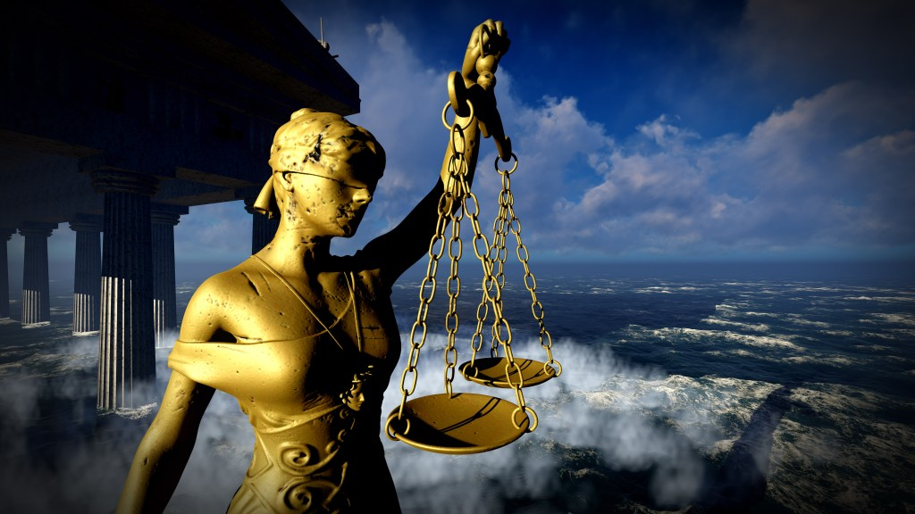 Image of classical statue depicting blind justice with scales. True Justice is Moral, it treats everyone's interests equally