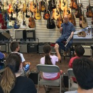 "Greg answers questions at a ""Pointers for Players"" clinic hosted by Music and Arts in July of 2017."
