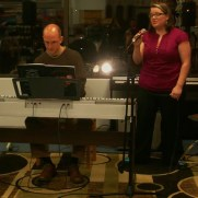 Jackie Collison joins Greg to perform at a Music and Arts open mic night night in 2011.